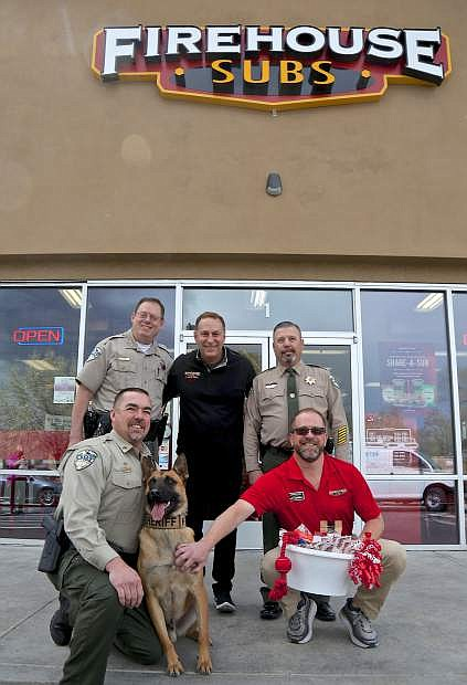 Firehouse Subs owner Damon Kreizenbeck (right) and Area Manager Scott Kinner (center) pose for a photo with Lyon County Sheriff Al McNeil, Commander Rob Hall and Deputies Wayne Hawley and 'Borys' Wednesday in Carson City.