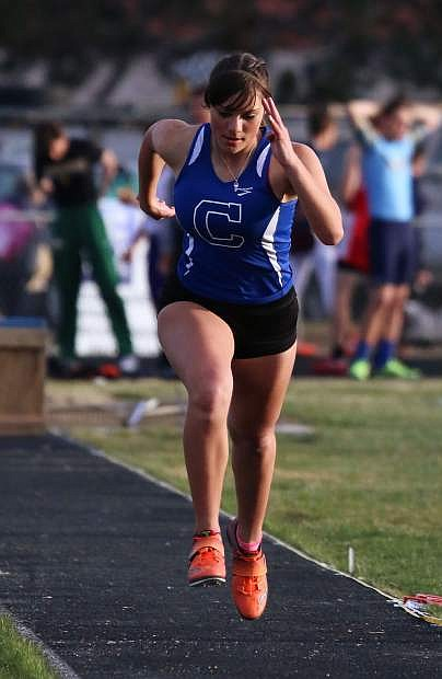 Carson High's Abbey Paulson competes in the triple jump on Friday at Reed High.