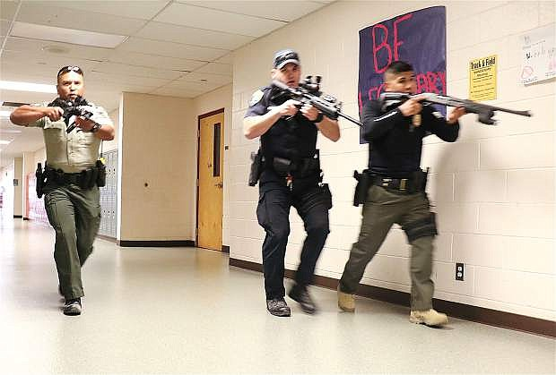 Sergeant Mel Jabines of Churchill County Sheriff's Office, far left, helps lead active shooter training scenarios with local law enforcement agencies, including Fallon Police Deparment, Tuesday at Churchill County High School.