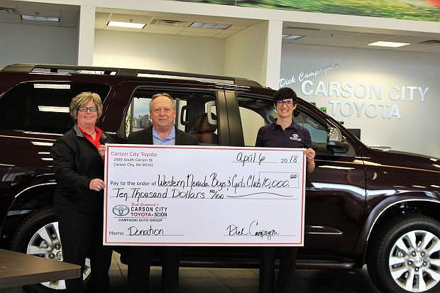 Roxanne Spring, president of the board of directors, and Katie Leao, chief professional officer for the Boys & Girls Clubs of Western Nevada, receive the Carson City Toyota Scion Community Challenge matching funds in the amount of $10,000 from Dana Whaley, general manager for Carson City Toyota Scion.