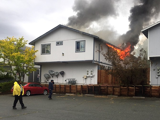 Courtesy Tim Anaclerio Three people were injured in an apartment fire on Pheasant Drive in Carson City Wednesday morning.