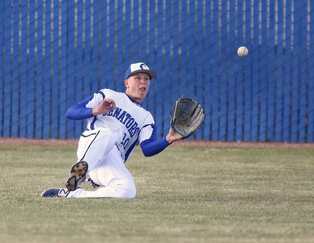 Right fielder Landon Truesdale makes a sliding catch for an out in a game against North Valleys on Tuesday.