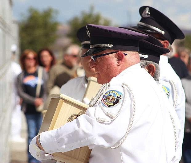 The Nevada Veterans Coalition is conducting a procession and interment at the Northern Nevada Veterans Memorial Cemetery for 10 servicemen whose remains were unclaimed.