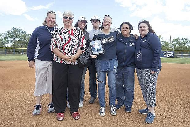 T Moe receives the Jayme King Inspiration Award from members of the King family on Friday.