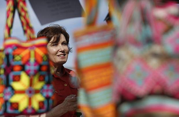 In this May 5, 2018, photo, Rep. Jacky Rosen, D-Nev., speaks with vendors at a Cinco de Mayo festival in North Las Vegas, Nev. Rosen is running for the U.S. Senate. Democrats hoping to take control of the U.S. Senate in November believe one of their best chances to pick up a seat this year lies in battleground Nevada, where Sen. Dean Heller is the only Republican running for re-election in a state that Democrat Hillary Clinton carried in 2016. (AP Photo/John Locher)