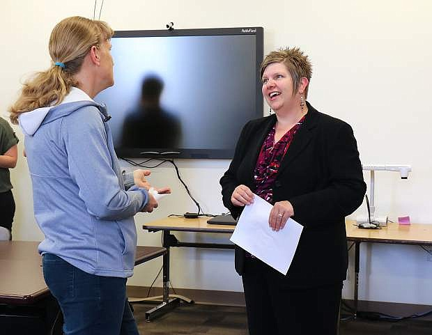 Newly appointed Churchill County School District Superintendent Summer Stephens, right, chats with community members during the meet and greet event.