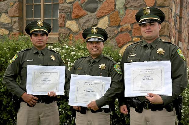 Deputies Daniel Loyola, Joshua Valdes and Kyle Smith pose for a photo following POST graduation ceremonies Wednesday at the Stewart Complex.