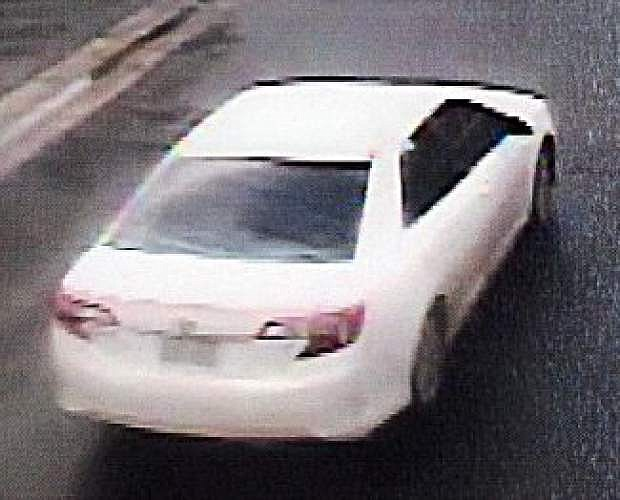 The suspects were driving a white Toyota sedan.