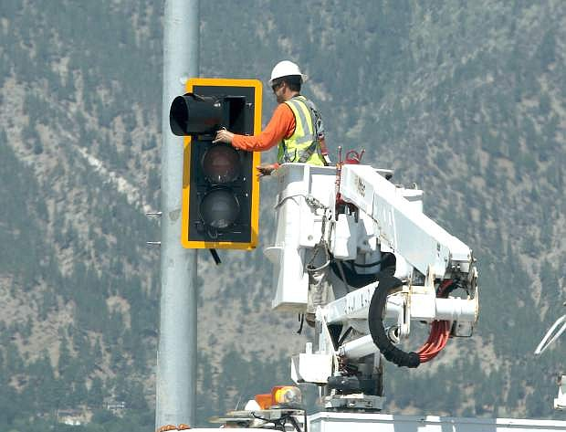 Traffic lights are installed at the Airport Road and Highway 395 intersection on Monday.