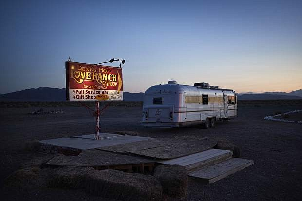 In this April 27, 2018, photo, a sign advertises the Love Ranch brothel in Crystal, Nev. A coalition of religious groups and anti-sex trafficking activists have launched referendums to ban brothels in two of Nevada's seven counties where they legally operate. (AP Photo/John Locher)