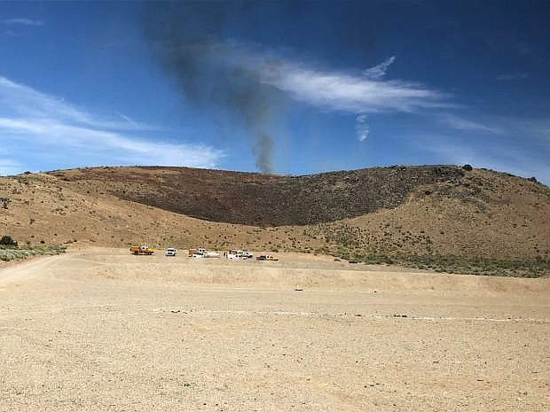 This photo from the Carson City Fire Department Facebook page shows smoke from a brush fire at the Carson Rifle and Pistol Range on Tuesday.