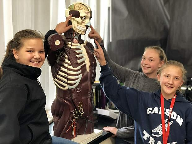Left to right: Carson Middle School sixth grade HOSA students Jocelynne Solorio, Bailey Rasner and Kate Lucas.