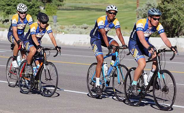 Four cyclists from Journey of Hope pedal on U.S. Highway 50.