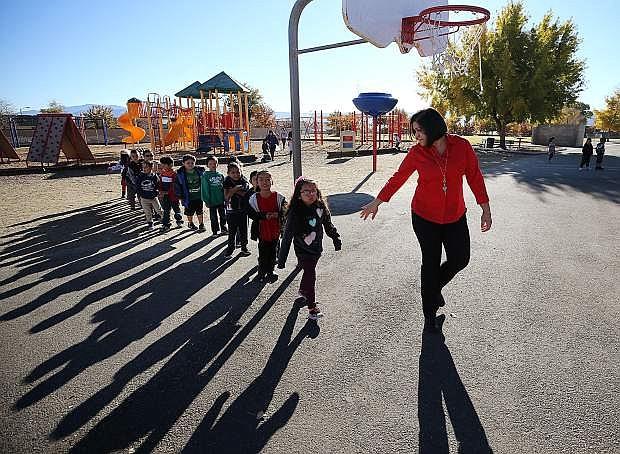Kindergarten teacher Maria Royce works the playground at recess at Mark Twain Elementary School in Carson City, Nev., on Tuesday, Oct. 24, 2017. Photo by Cathleen Allison/Nevada Momentum