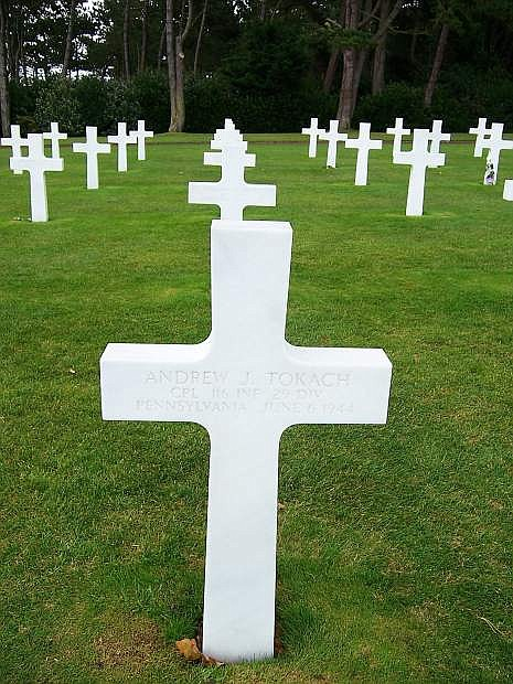 This is the grave marker for Cpl. Andrew J. Tokach, 116 INF 29 Division, Pennsylvania, June 6, 1944. More than 2,000 of our boys died on June 6. The Normandy American Cemetery is the final resting place for 9,400 American men and women with 38 sets of brothers buried side by side.