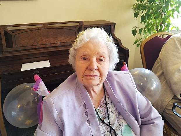 Dorothy Hulbert, wearing a gold crown with pearls, celebrates her 100th birthday Tuesday at Sierra Place Senior Living.