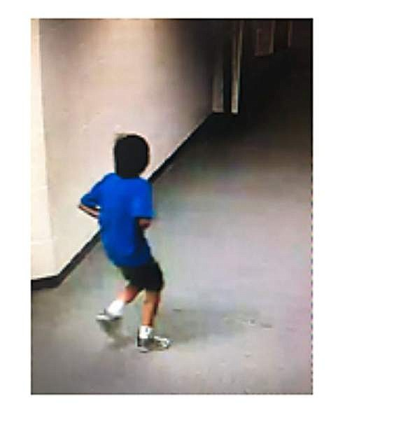 A suspect in vandalism at Pau Wa Lu school is a male, 9-12 years of age with dark, collar-length hair, wearing a blue T-shirt, dark shorts and light colored athletic shoes.