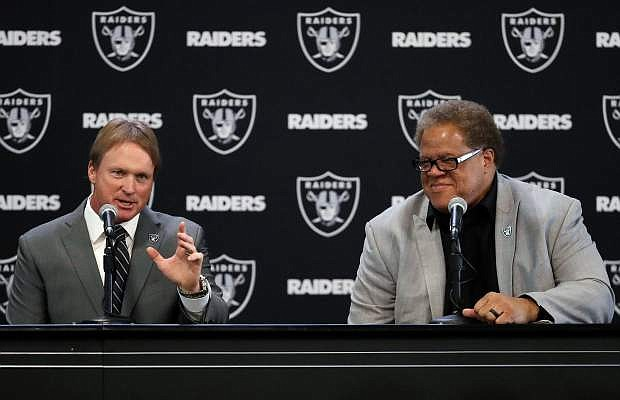 In this Jan. 8, file photo, Oakland Raiders new head coach Jon Gruden, left, answers a question next to general manager Reggie McKenzie during an NFL football news conference in Alameda, Calif. There's talk the Raiders could hold their training camp in Reno.