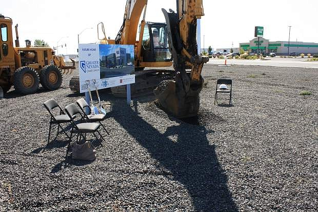 Joyce Whitney Silva, EVP/CFO for Greater Nevada Credit Union, breaks ground on its new branch in Fernley. Shaheen Beauchamp Builders is the general contractor for the site.