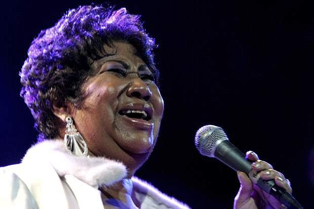 FILE - In this Nov. 21, 2008 file photo, Aretha Franklin performs at the House of Blues in Los Angeles. Franklin died Thursday, Aug. 16, 2018 at her home in Detroit. She was 76. (AP Photo/Shea Walsh, file)