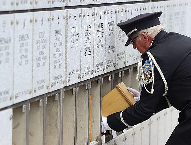 A member of the Nevada Veterans Coalition slides an urn into the columbarium at the Northern Nevada Veterans Memorial Cemetery during a previous mission in May.