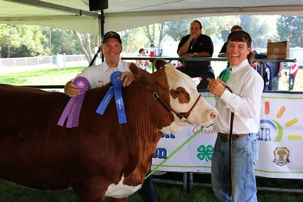 Lander Smith with his Grand Champion steer.