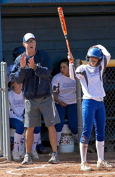 Coach Shane Quilling encourages his players during the first game of a double-header with Galena.