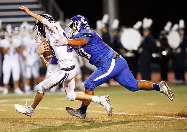 Carson High's Johnathan Acosta sacks Spanish Springs High Quarterback Tristan Szabo during their game against Spanish Springs High, Carson High School, Carson City, NV