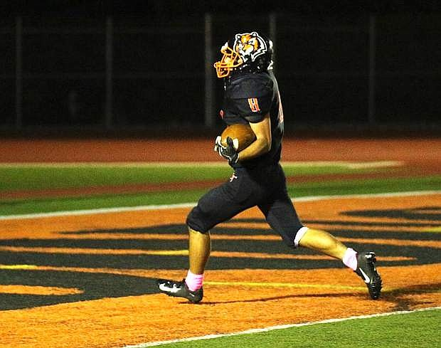Trevor Kruger finds the end zone for the Tigers on Friday night against Galena.