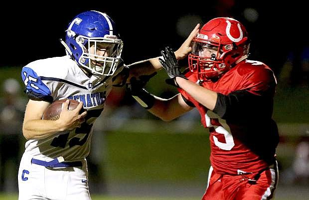 Carson's Jonathan Laplante stiff arms a Wooster defender during Friday night's game.