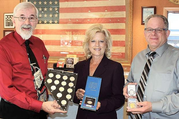 Michael Flanagan, Dorothy Tisdel and Mike Johnson show off the famous Morgan Silver Dollars minted in at the U.S. Mint in Carson City. They are employed at Northern Nevada Coin, 601 N. Carson Street, located right across the street from the Nevada State Museum which houses the former mint. Northern Nevada Coin has a large collection of uncirculated and circulated cc marked coins.