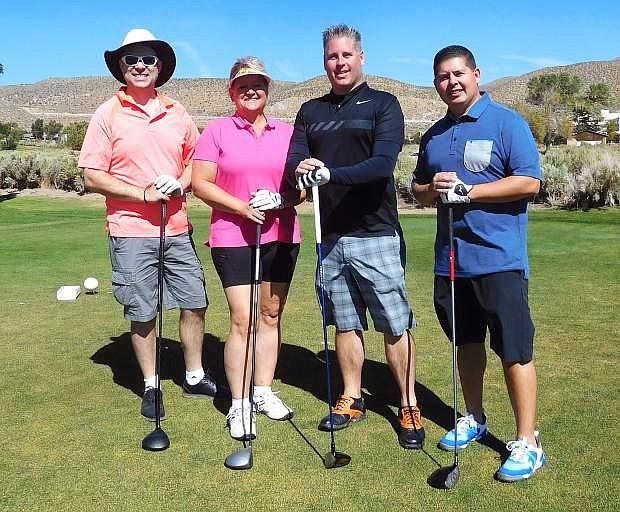 Melissa Harlow, John Ahdunko, Tom Wambaugh, and Tom Wheeler, from Greater Nevada Credit Union, scored 54
