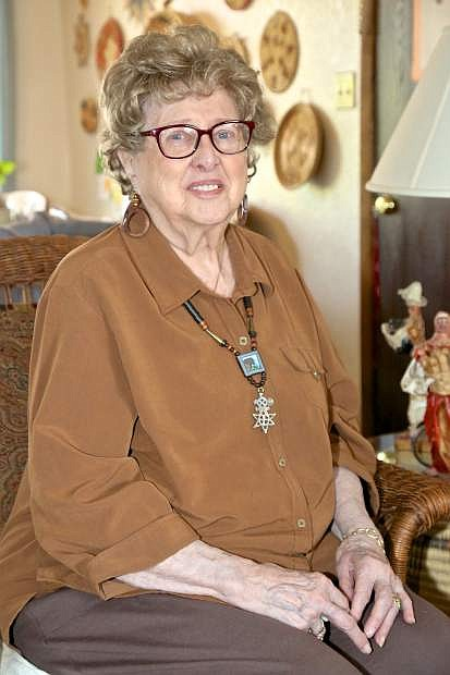Florence Phillips poses for a photo in her home in Carson City on Thursday.