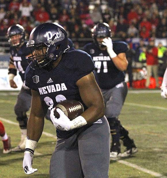 Kelton Moore runs for Nevada against Fresno State. Nevada finds itself at a crossroad.