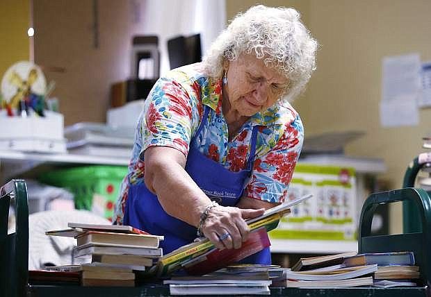 Browsers Corner Book Store manager Patti Ferguson, works in the store, in Carson City, Nev., on Thursday, Sept. 27, 2018. The bookstore is the primary revenue source of Friends of the Carson City Library, which raises money to help support programs at the library. Photo by Cathleen Allison/Nevada Momentum