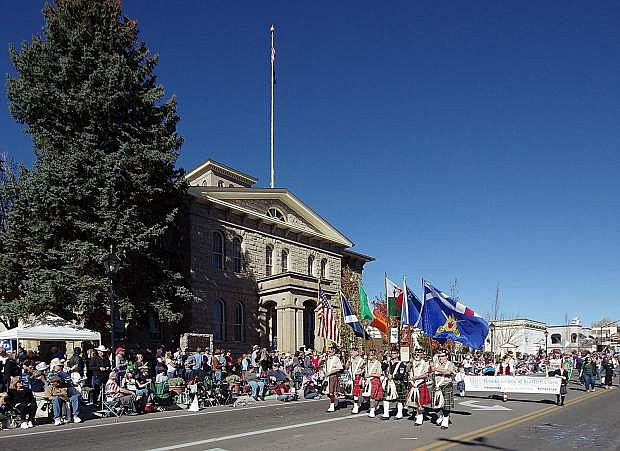 Nevada Day Parade crowds line the street in front of the Nevada State Museum, formerly the U.S. Branch Mint, during the 2017 Nevada Day Parade.