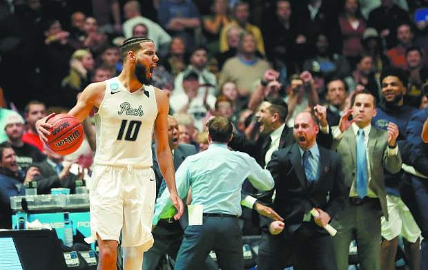 Nevada forward Caleb Martin (10) reacts after defeating Texas in overtime of a first-round game of the NCAA college basketball tournament in Nashville, Tenn., Friday, March 16, 2018. Nevada won 87-83. (AP Photo/Mark Humphrey)