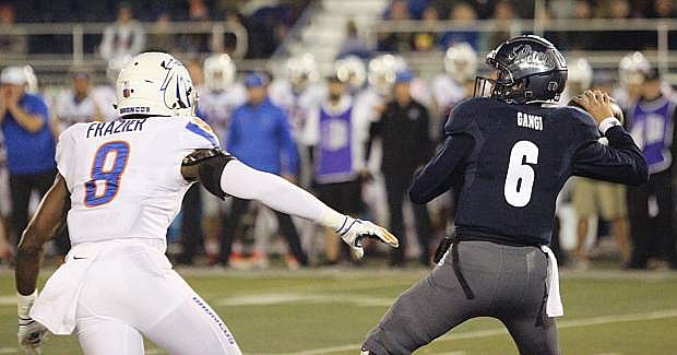Nevada quarterback Ty Gangi passes against Boise State on Saturday.