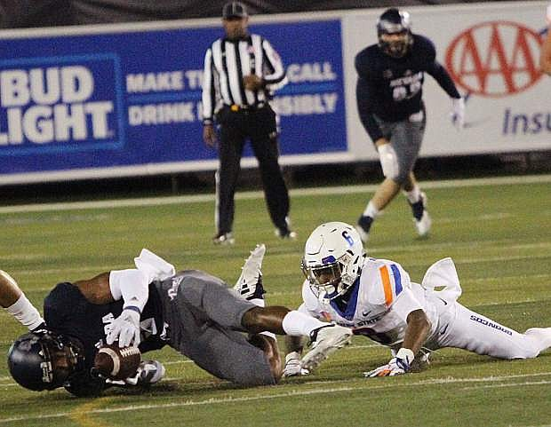 Nevada safety Dameon Barber, left, intercepts a pass in the first quarter against Boise State. Nevada is ranked No. 5 in the Nevada Appeal Mountain West rankings.