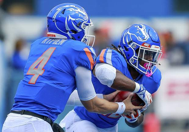 Boise State running back Alexander Mattison receives a hand off from quarterback Brett Rypien on Saturday against San Diego State.