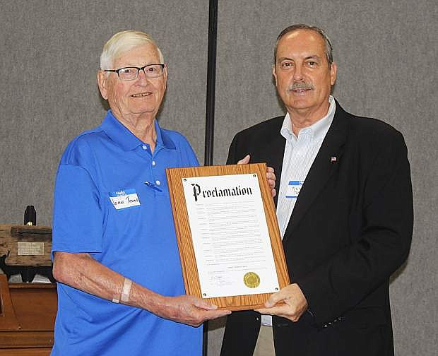 Fallon Mayor Ken Tedford, right, read a proclamation honoring John Tewell on his 90th birthday.