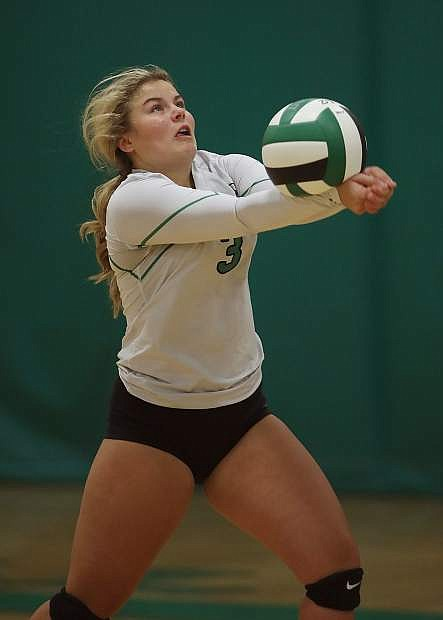 Fallon senior Lorynn Fagg passes the ball in the first game of Friday's match against Elko.