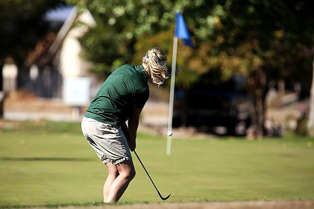 Fallon senior Allison Lister aligns the ball with the flag stick at the Fernley golf course.