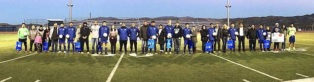 The seniors on the 2018 Carson High boys soccer team and their families are seen before the start of Wednesday's game.