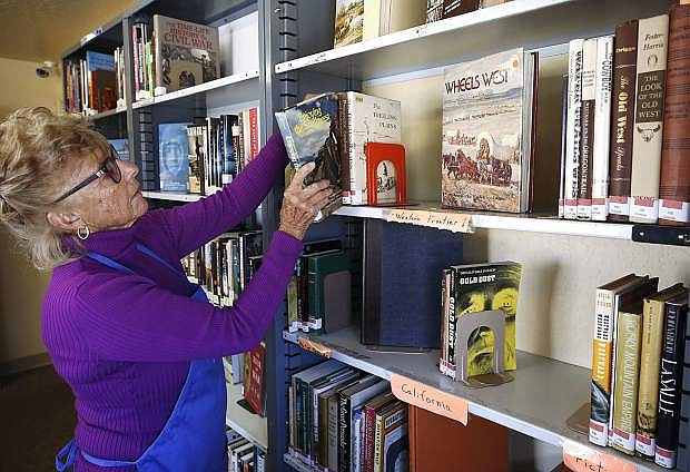 Volunteer Patti May works in the Nevada and the West section of the Browsers Corner Book Store in Carson City, Nev., on Monday, Oct. 22, 2018. Photo by Cathleen Allison/Nevada Momentum