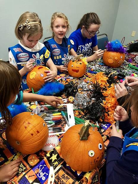 Members of Girl Scouts of The Sierra Nevada Troop 252 decorate pumpkins for seniors who participate in Meals on Wheels Carson City at the Carson City Senior Center.