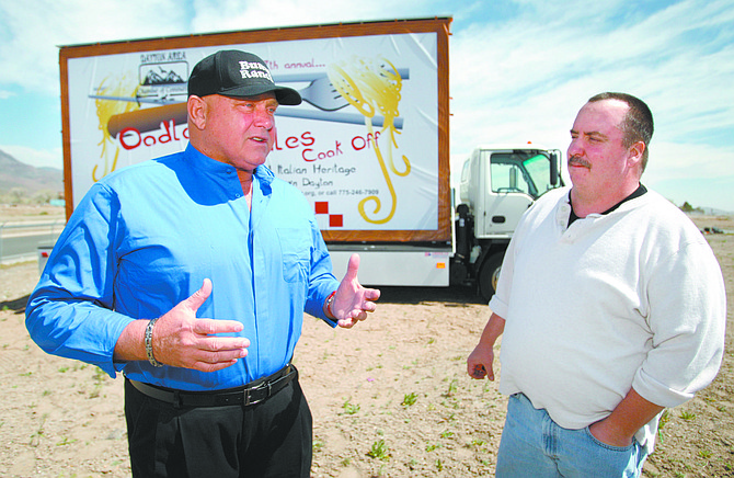 Published Caption: Cathleen Allison/Nevada Appeal Dennis Hof, left, talks Tuesday about using his new billboard truck to promote local community events. John Stevens, chair of the Oodles of Noodles Cook Off in Dayton, right, said the publicity from the truck has been helpful.   Photographer's Caption: Cathleen Allison/Nevada Appeal Dennis Hof, left, talks Tuesday about using his new billboard truck to promote local community events. John Stevens, chair of the Oodles of Noodles Cook-Off in Dayton, right, said the publicity from the truck has been helpful.