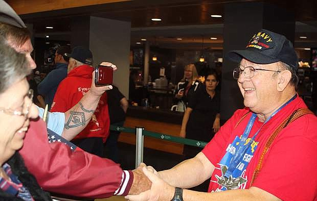 Paul Ortiz of Fallon shakes hands with friends at the Reno-Tahoe International Airport.