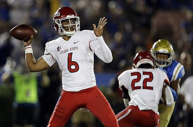 Fresno State quarterback Marcus McMaryion, shown against UCLA on Sept. 15, will lead the Bulldogs into Mackay Stadium on Saturday.