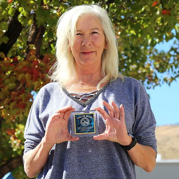 Cheryl Hansen on Monday with the medallion.